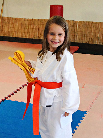summer-karate-orange-belt-by-herself.jpg
