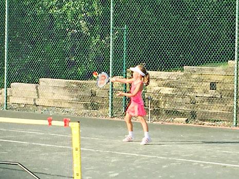 july-tennis-hit.jpg