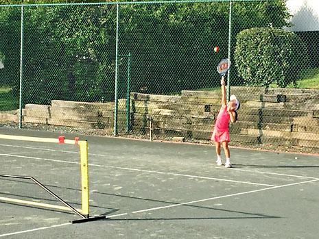 july-tennis-serve-far.jpg