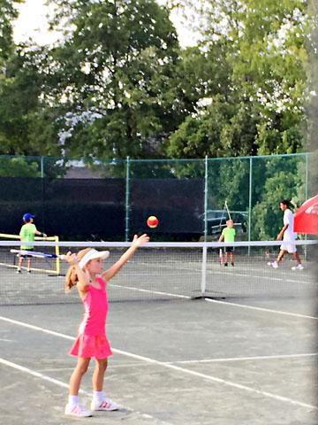 july-tennis-serve.jpg